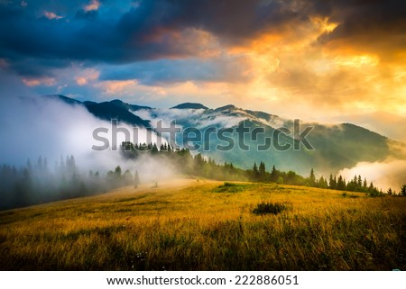 Amazing mountain landscape with fog and a haystack #222886051