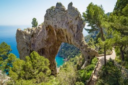 Amazing natural geological phenomenon - Arco Naturale, natural arch on coast of Capri island, Italy.