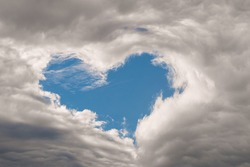 Amazing natural phenomenon of the heart shape appears in the cloudy dramatic sky.