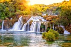 Amazing nature landscape, beautiful waterfall at sunrise, famous Skradinski buk, one of the most beautiful waterfalls in Europe and the biggest in Croatia, outdoor travel background