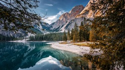 Amazing nature landscape. Scenic image in Sunny day of the Braies Lake, Pragser Wildsee in Dolomites mountains, Sudtirol, Italy. Impressive Lago di Braies. Iconic location for landscape photographers