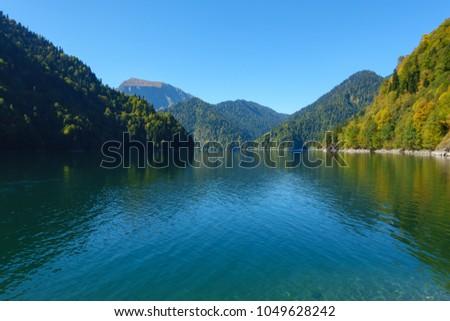 Amazing nature landscape view of beautiful lake Ritsa and Caucasian mountains, Abkhazia #1049628242
