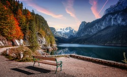 Amazing nature landscape. Wonderful Picturesque sunset over the Gossausee lake in Austrian Alps. Travel adventure concept. Concept of ideal resting place of outdoor. Picture of wild nature