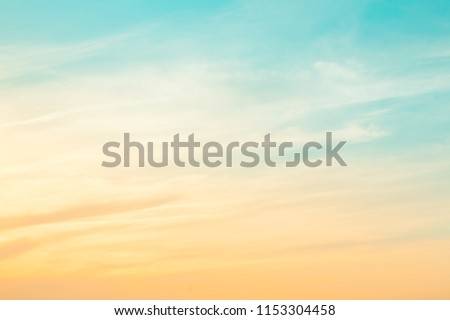 Amazing Nature sky background, texture for Design. Beautiful morning sky at dawn in the rays of the sun. Pastel cloudscape. Soft Wallpaper or Web banner With Copy Space