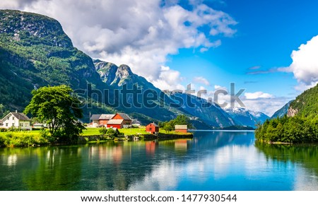 Amazing nature view with fjord and mountains. Beautiful reflection. Location: Scandinavian Mountains, Norway. Artistic picture. Beauty world. The feeling of complete freedom Stockfoto ©