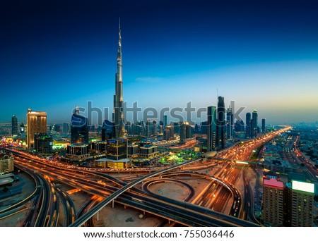 Amazing night dubai downtown skyline. Colorful summer sunset. Panorama of business area with tallest skyscraper of the world. Dubai, United Arab Emirates