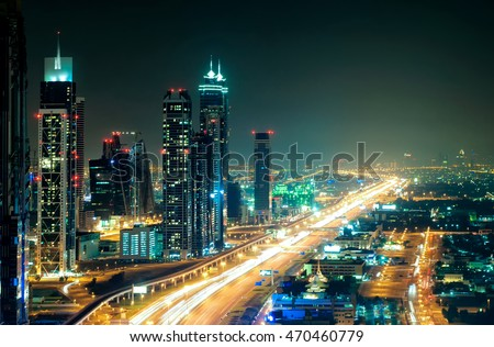 Amazing night dubai downtown skyline with tallest skyscrapers and road leading to Abu Dhabi during rush hour, Dubai, United Arab Emirates #470460779