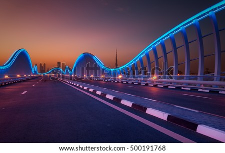 Amazing night dubai VIP bridge with beautiful sunset. Private road to Meydan race course, Dubai, United Arab Emirates
