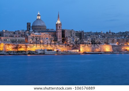 Amazing night view from the sea on the harbor of Valletta, Malta.