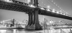 Amazing night view of Manhattan Bridge with city skyline.