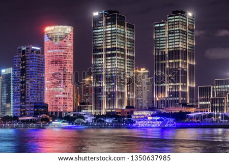 Amazing night view of modern waterfront buildings at the Pudong New Area (Lujiazui) in downtown of Shanghai, China. Colorful city lights reflected in water of the Huangpu River. #1350637985