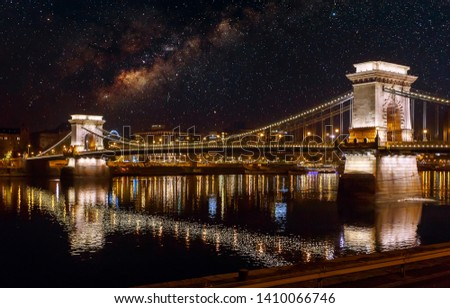 Amazing night view on Chain Bridge, Budapest with the illuminated. Fantastic Cityscape with stars sky and Milky Way. Hungarian landmarks. Popular Travel destinations. #1410066746