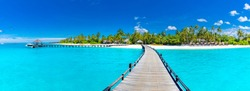 Amazing panorama landscape of Maldives beach. Tropical beach landscape seascape, luxury water villa resort wooden jetty. Luxurious travel destination background for summer holiday and vacation concept