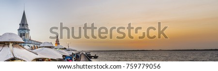 Shutterstock Amazing panorama of famous Ver o Peso Market, in Belem do Para, Brazil, with golden sky and the river at sunset