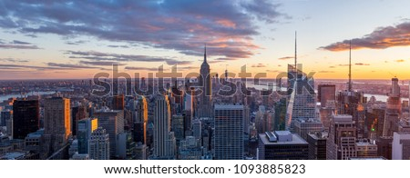 Amazing panorama view of  New York city skyline and skyscraper at sunset. Beautiful night view in Midtown Manhatton.