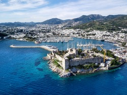 Amazing panoramic view from drone of beautiful full of yachts Bodrum harbour and ancient Kalesi castle in Mugla province in Turkey