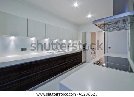 amazing penthouse kitchen with white stone worktop - stock photo