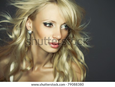 Amazing portrait of beautiful young blond woman. Close-up face studio photo.