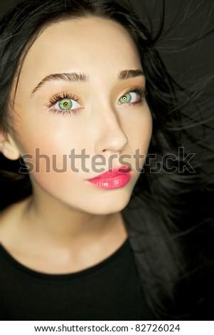 Amazing portrait of beautiful young brunette woman. Close-up face studio photo.