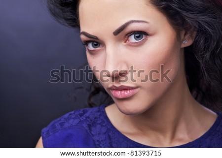 Amazing portrait of beautiful young caucasian woman. Close-up face studio photo.