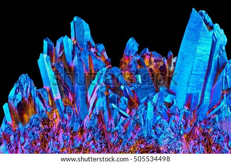 Shutterstock Amazing rare Quartz Rainbow Titanium aura crystal cluster on black background