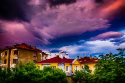 Amazing Red Orange Purple Blue Sky over traditional houses in Sofia Bulgaria during sunset