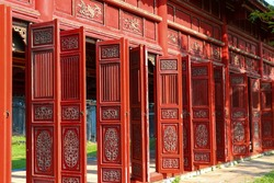 Amazing red wooden hallway in the Purple Forbidden City of the Imperial City within the Citadel in Hue, Vietnam. Hue is a popular tourist destination of Asia