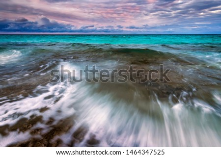 Amazing scenic seascape with motion blur and flowing waves.