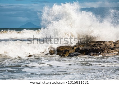 Amazing seascape on a sunny day and strong stormy waves. Location place Gioiosa Marea, Sicily, Italy, Europe. Mediterranean coast. Forces and beauty of untouched nature. Discover the beauty of earth.