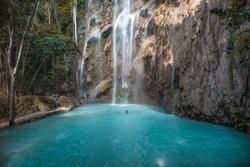 Amazing secret waterfall with blue turquoise water. Tumalog, Kawasan Philippines Cebu Island.