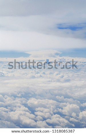 Amazing skyscape of cloudy blue sky from plane's view. Space for dreaming, desires, thoughts, new prospects and future. Airtransport for travel, tourism and business. #1318085387
