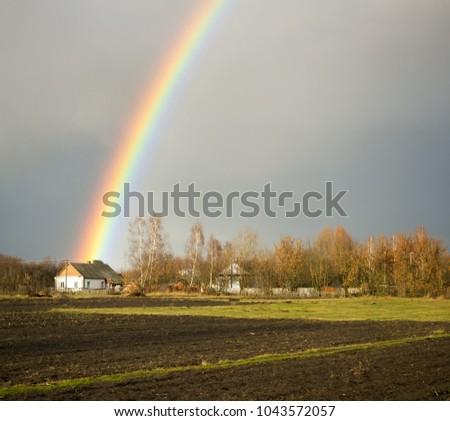 amazing spring landscape with rainbow
