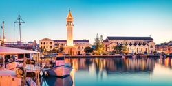 Amazing spring sunset in Zakynthos city. Beautiful evening panorama of town hall and Saint Dionysios Church, Ionian Sea, Zakynthos island, Greece, Europe. Traveling concept background.