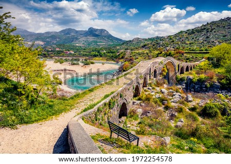 Amazing spring view of Old Mes Bridge. Stunning morning landscape of Shkoder. Picturesque outdoor scene of Albania, Europe. Traveling concept background. Stock photo ©