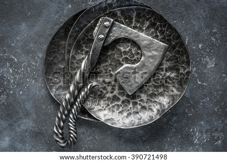Amazing steel handmade axe lying on metal textured dished on dark grey grunge concrete background. Perfect for fresh meat. Tableware.  #390721498
