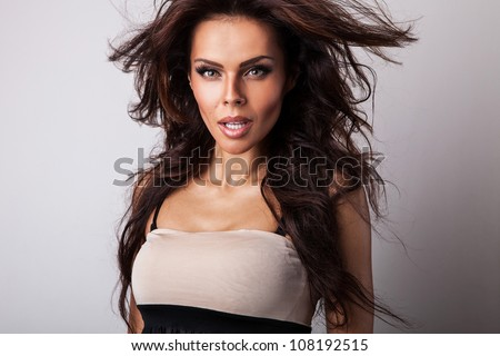 Amazing studio portrait of beautiful woman.