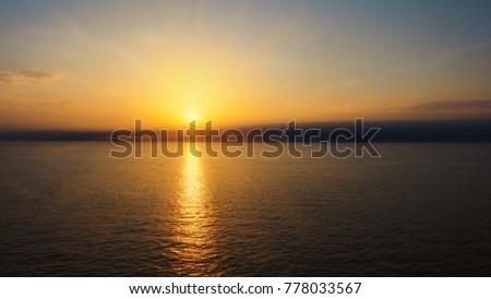 Amazing sundown on opened sea #778033567