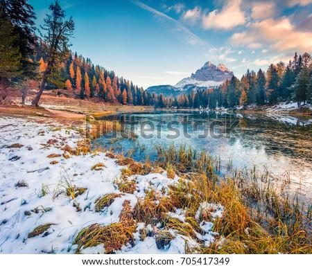 Amazing sunny scene of Antorno lake with Tre Cime di Lavaredo (Drei Zinnen) mount. Colorful autumn landscape in Dolomite Alps, Province of Belluno, Italy, Europe. Beauty of nature concept background.