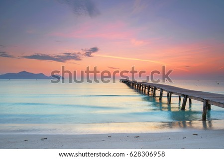 amazing sunrise at wooden Pier on the beach                                        #628306958