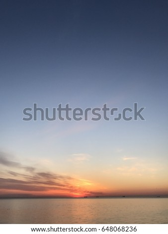 Amazing sunrise on the sea,beautiful sky,landscapes,blue sky with clouds,Smooth surface,amazing morning,seascape,Sunny path,clear sky,grey clouds,soft,background,soft,white,colors,orange sun
