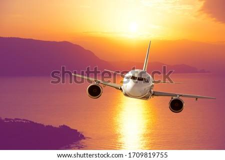 amazing sunset and passenger plane stock photo
