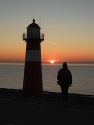 amazing sunset in Netherlands with a lighthouse