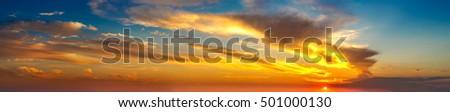 Amazing sunset panorama in a beautiful summer evening #501000130