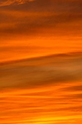 Amazing sunset sky with red orange fire color clouds. Beautiful nature moment. Great for backgrounds and textures.