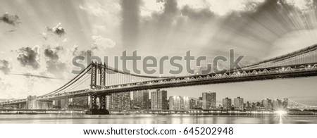 Amazing sunset view of Manhattan Bridge with East River reflections - New York City. #645202948