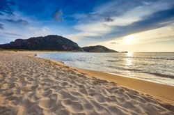 Amazing sunset view with multicolored clouds. Incredibly romantic sunrise on Voidokilia beach, Ionian Sea, Pilos town location, Greece, Europe. View of the ocean. Tropical beach