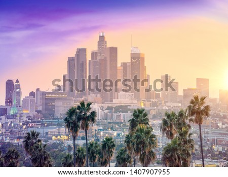 Amazing sunset view with palm tree and downtown Los Angeles. Cal #1407907955