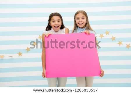 Amazing surprising news. Girl hold announcement banner. Girls kids holding paper banner for announcement. Children happy with blank paper announcement copy space. Kids announcement concept. #1205833537