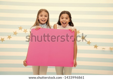 Amazing surprising news. Girl hold announcement banner. Girls kids holding paper banner for announcement. Children happy with blank paper announcement copy space. Kids announcement concept. #1433996861