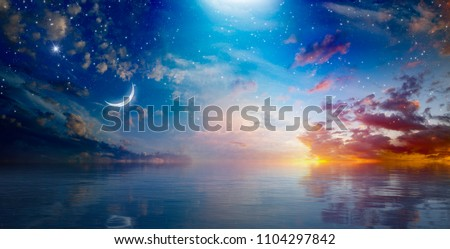 Amazing surreal background - crescent moon rising above serene sea in sunset sky, glowing horizon and bright stars.  Elements of this image furnished by NASA